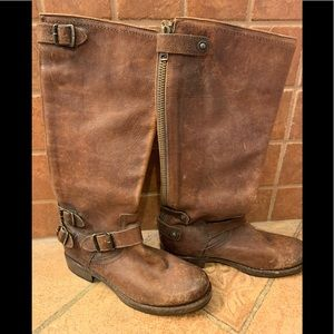Frye boots in distressed brown.
